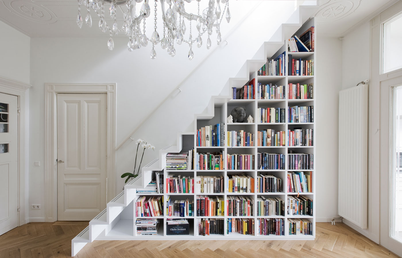 a diy bookcase in a staircase is one of many creative book storage VMFFHZT