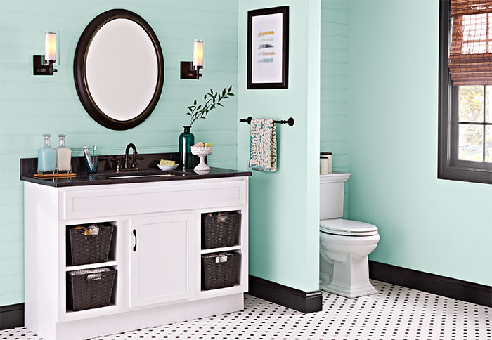 bathroom color green walls and white-painted vanity HRVSTGK