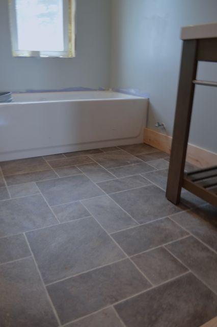 bathroom flooring ideas barn bathroom laminate floor2 -- i want this vinyl flooring in my renovated RPPAQCO