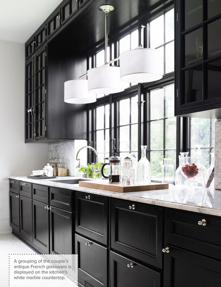 black kitchen cabinets natural light as balancing feature. RHSRQBZ