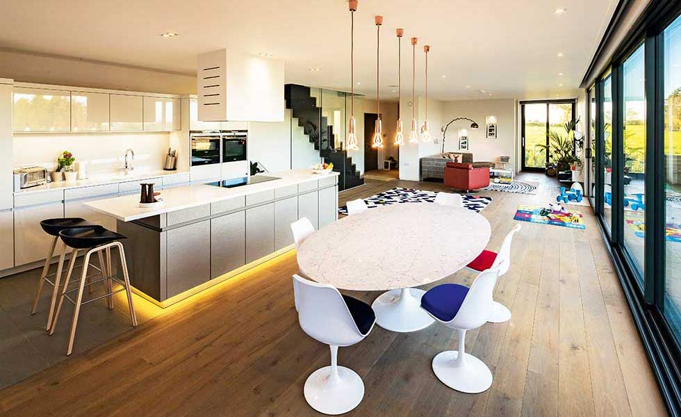 contemporary open plan kitchen in a self build SVGJNYD