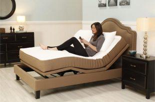 customer enjoying one of our adjustable beds in plainfield, in RARTMKK