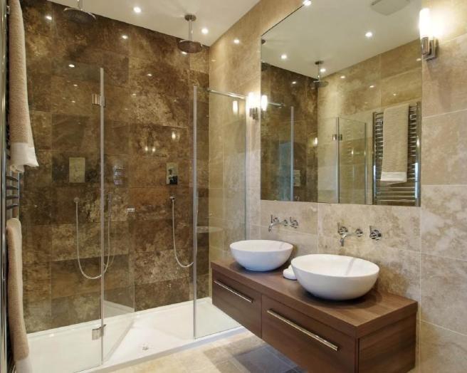 en suite bathroom photo of beige brown bathroom ensuite ensuite bathroom with cabinets double  sink DHATIBP