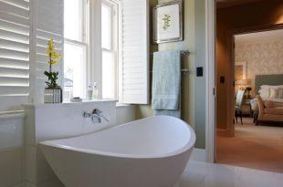 en suite bathroom white en-suite bathroom with green stripe wallpaper GDCJVPH