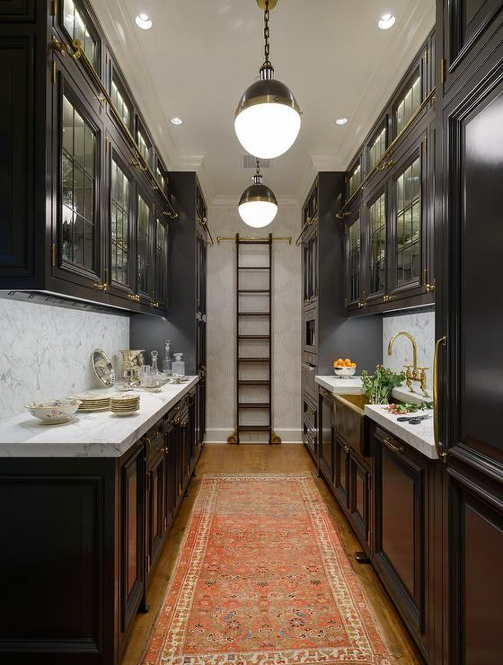 galley kitchens black galley style kitchen features a row of hicks pendants illuminating  glass BRRPURP