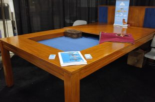 game table tablezilla in french couture finish and dark blue fabric. note there are 2 DTCJVXY