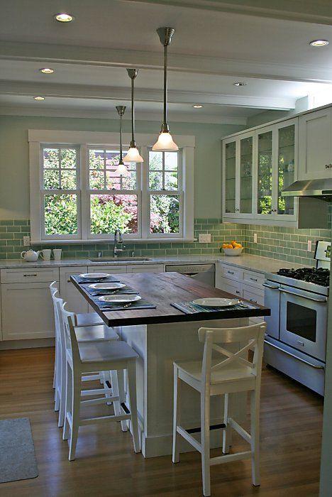 kitchen island table communal setups top list of new kitchen trends WDPBGIF