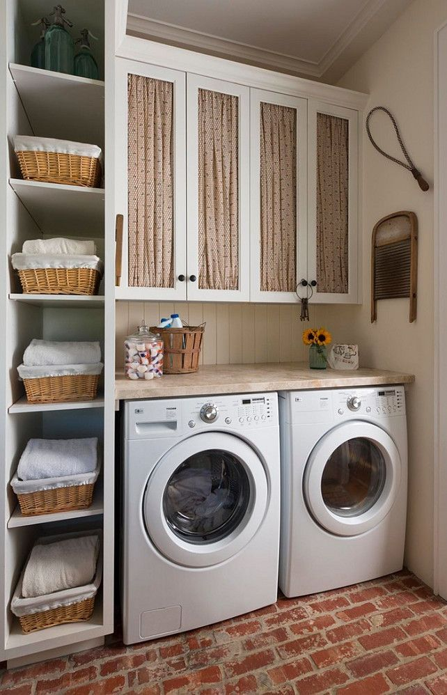 laundry room cabinets baskets around the washing machines DBESACZ