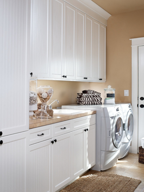 laundry room cabinets traditional laundry room idea in portland with white cabinets WGBQMXC