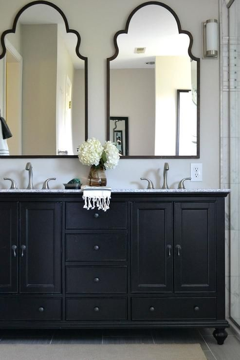 mirrors for bathrooms this neutral master bathroom features a beautiful black double vanity with  mirrors. YXICBMU