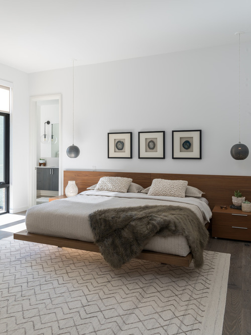 modern bedroom example of a minimalist master bedroom design in dallas with white walls KJCAXYP