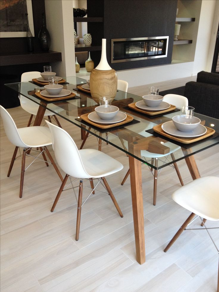 sticotti glass dining table and eames dining chairs in walnut JUGRSFE