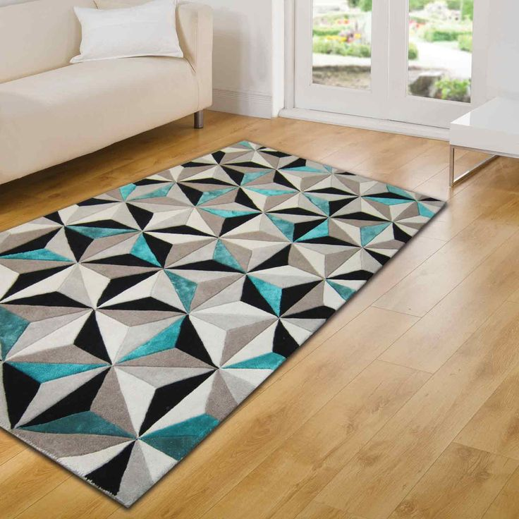 teal rugs the soft pile features a black, white with shimmering teal fibres that BTKPEVD