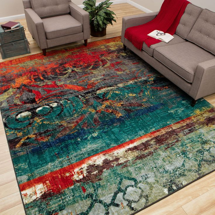 Best rug this colorful area rug features bright hues of blue, red and orange to SVZVRDT