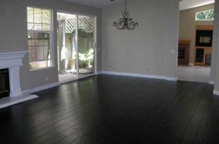 black hardwood flooring black hardwood floor to match stone fireplace, grey/yellow/ white decor CGFDQEK