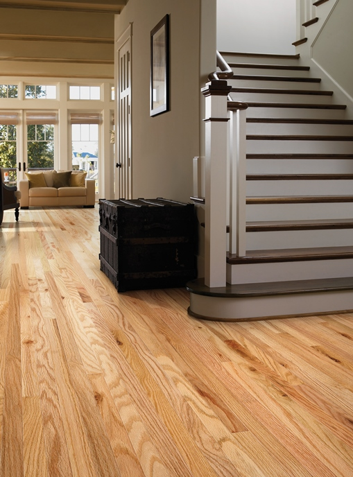 budget friendly flooring bright entryway with wide staircase and light oak harding hardwood floors WGTXELT