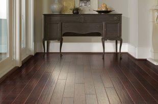 budget friendly flooring dark laminate or vinyl flooring that looks like wood HERRNWO