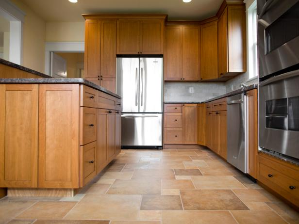 kitchen flooring materials spacious kitchen with wood and tile EFHNAMG