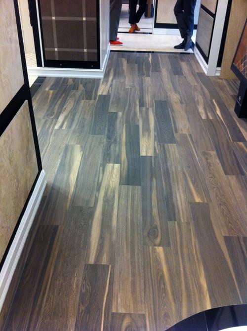 Laminated look real wood floor vs. ceramic wood-look tiles? SNTCUAM