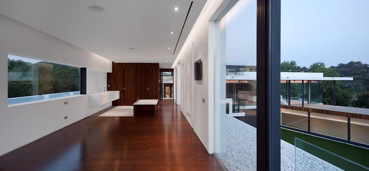 modern dark wood floors bathroom, dark wood floor, modern home with a unique suspended pool in OWHJOCM