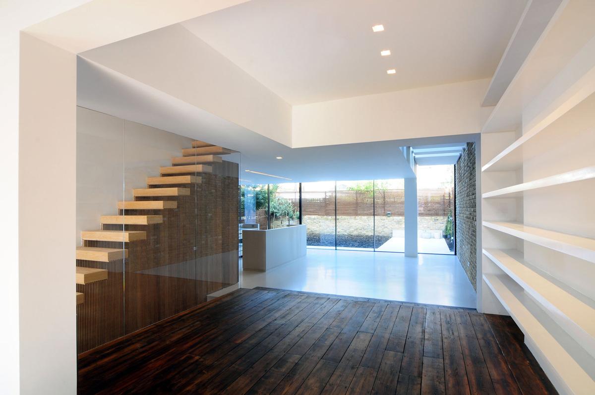modern dark wood floors dark wood flooring, stairs, glass wall, modern home in london by bureau de VJHMRGL