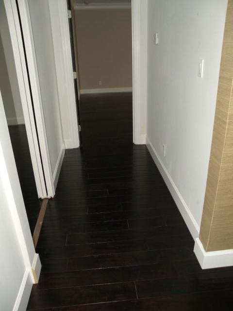 modern dark wood floors dark wood floors modern-family-room DPPOCZN
