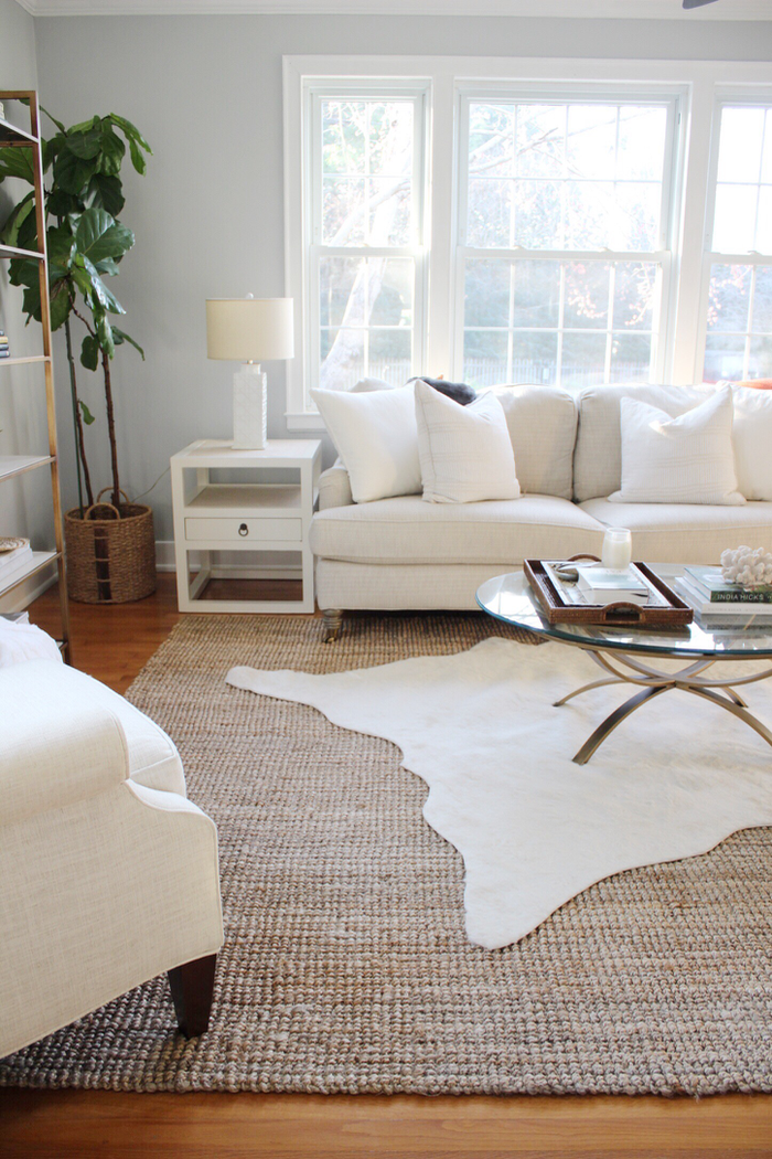 rug decor 3 simple tips for using area rugs in rental decor + sources for ACPNUES