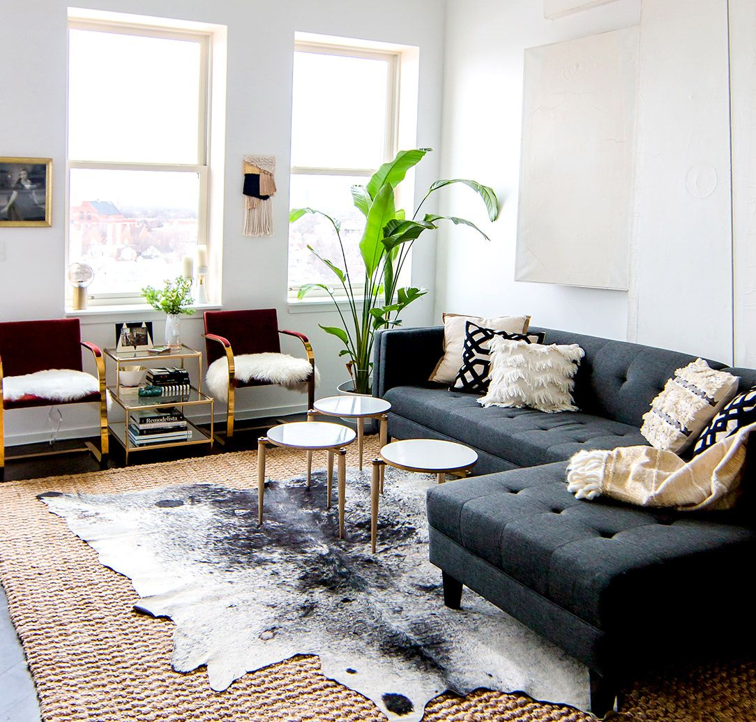 rug decor gray sofa with modern coffee tables, cowhide rug, and indoor plants. i love XLQRLSV