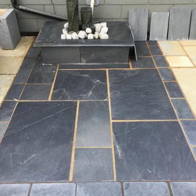 slate flooring geometric slate paving with a slate water feature BEOUUZJ