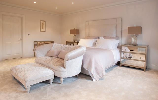 sofas for bedroom inspiration for a transitional master carpeted bedroom remodel in surrey  with beige VRGDKKE