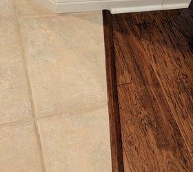 Tile hardwood we recently installed hardwood floors. the installers used a wide trim  between JGWIKLX