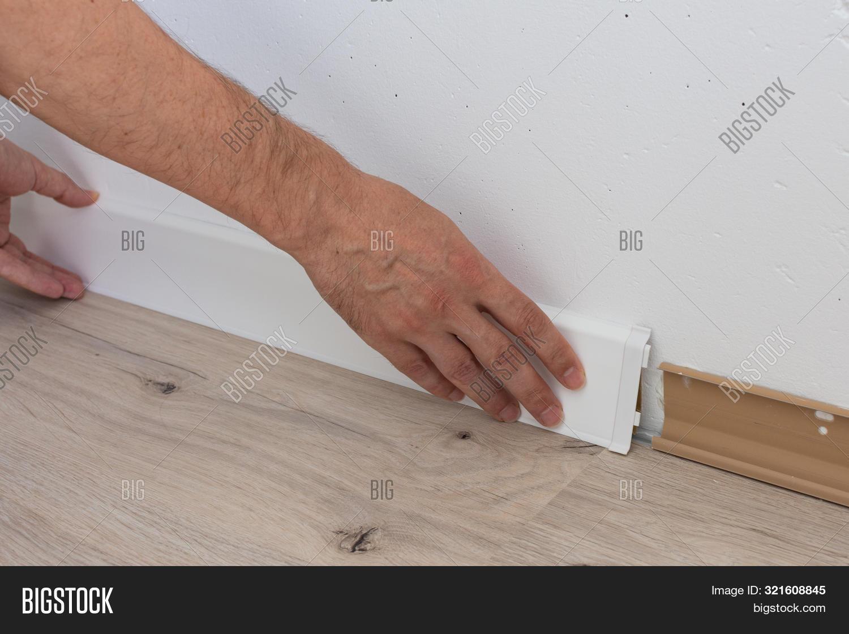 Installing the plastic laminate flooring