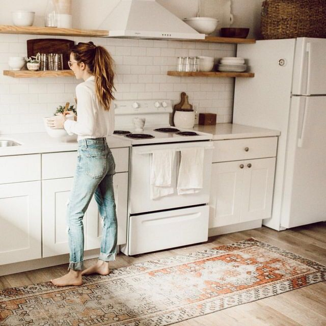 Tribal rug in kitchen with open wood shelving | Kitchen decor .