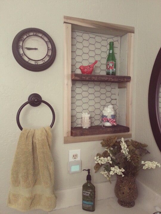 rustic shelving idea in place of old medicine cabinet space .