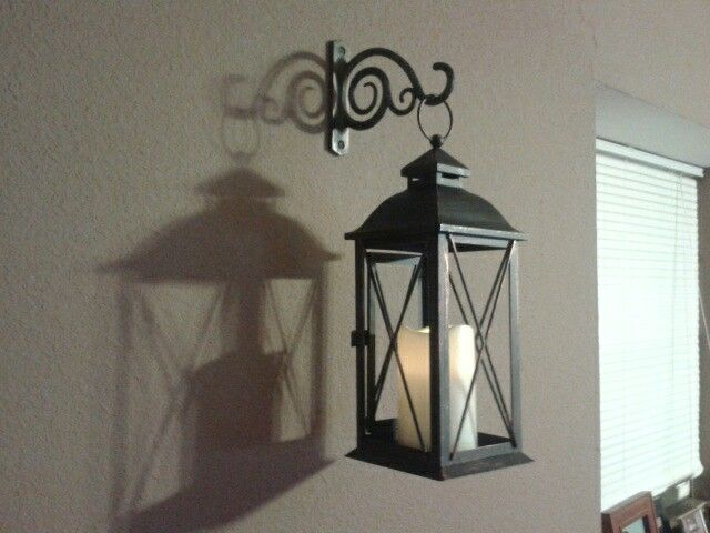 Cheap wall decor idea. Indoor/outdoor lantern with bracket used .