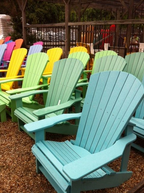 A rainbow of recycled plastic Adirondack chairs from The Cottage .