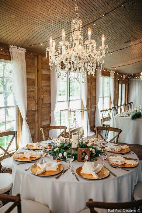 Rustic glam wedding decor - Gold table settings + greenery .