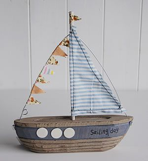 A small decorative wooden boat - The White Lighthouse | Boat decor .